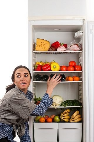 Woman with Night Eating Syndrome Opening the Fridge