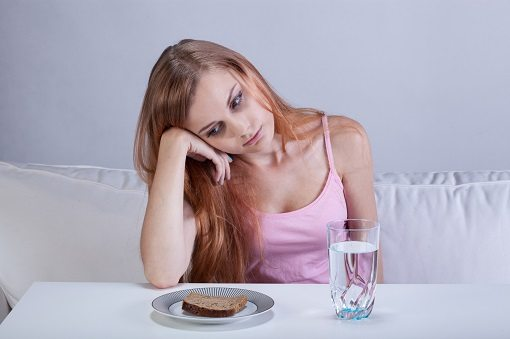 Portrait of young depressed girl with eating disorder