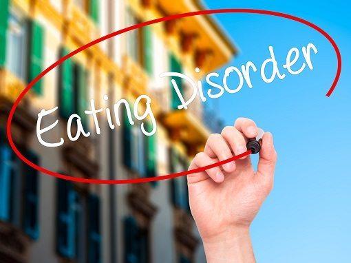 Man Hand writing Eating Disorder
