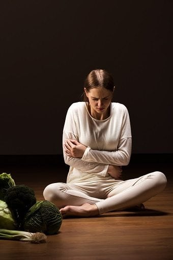 woman with eating disorder in a dark room